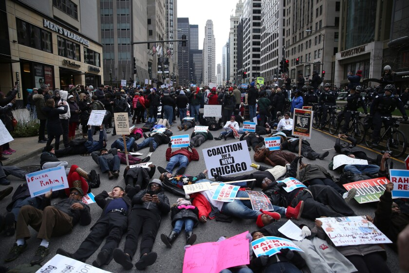 Protesters stage 'Black Christmas' in downtown Chicago