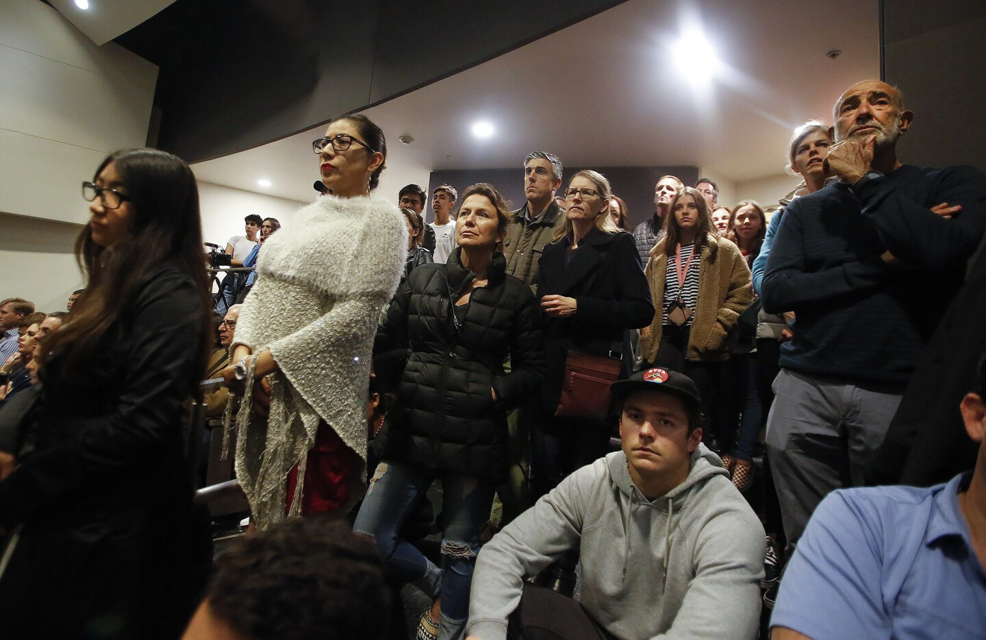Students, parents and other members of the community listen to a town hall-style discussion Monday night at Newport Harbor High School concerning pictures that emerged from an off-campus party that showed students saluting a swastika made of red cups.
