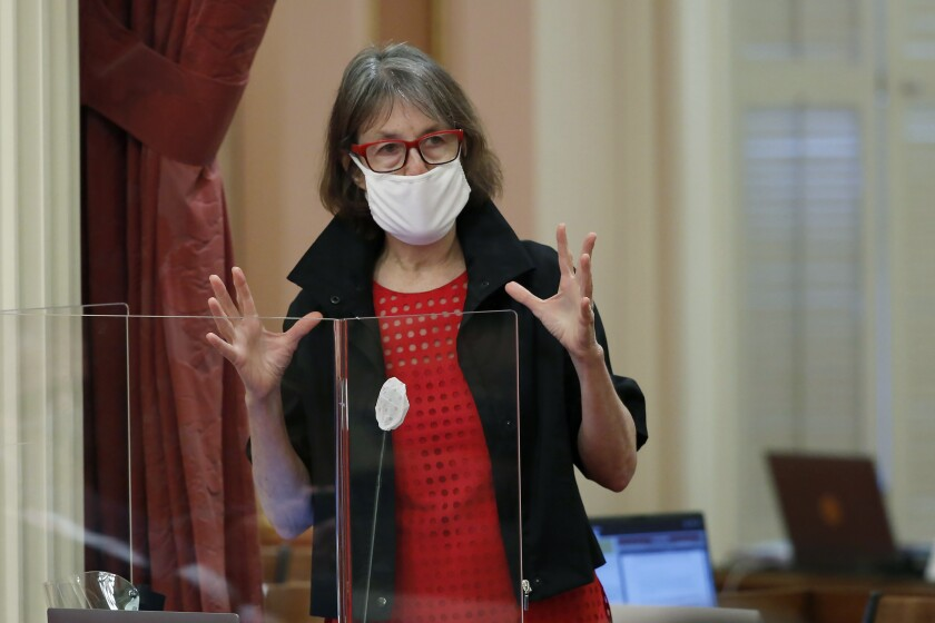 """FILE - In this June 25, 2020, file photo, Sen. Nancy Skinner speaks during debate at the Capitol in Sacramento, Calif. The California Legislature has passed a bill Thursday, April 15, 2021, requiring some hotels and event centers to offer laid-off workers their jobs back. Democrats say the the bill protects workers. State Sen. Nancy Skinner, a Democrat from Berkeley, said women lost more jobs and left the workforce in greater numbers than men during the pandemic. """"So you could also look at this bill as a very important bill to get women back in the workplace,"""" she said. (AP Photo/Rich Pedroncelli, File)"""