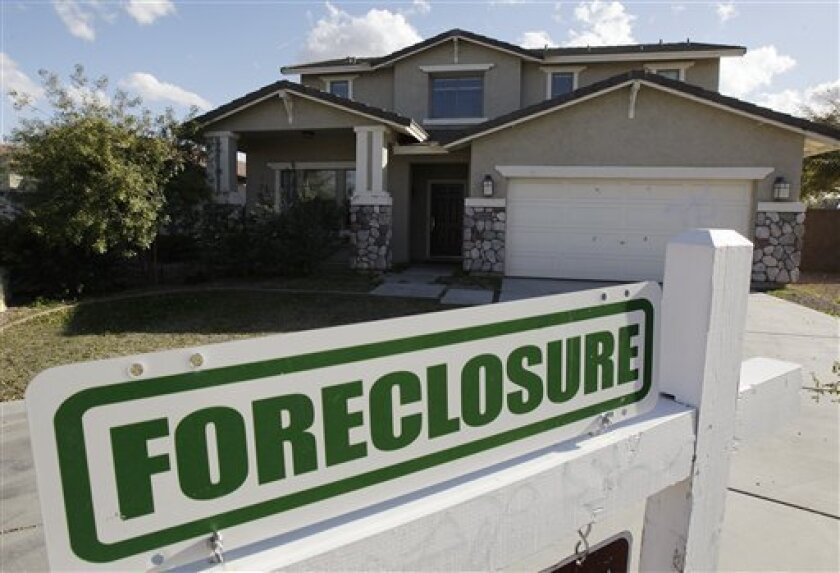 FILE - In this  Feb. 17, 2009 file photo, a foreclosure sign sits outside a home for sale in Phoenix. Arizona has one of the highest foreclosure rates in the country.  (AP Photo/Ross D. Franklin, File)