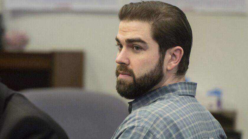 In this Dec. 9, 2015 photo, Daniel Wozniak sits in court as opening statements begin in his murder trial in Santa Ana, Calif.