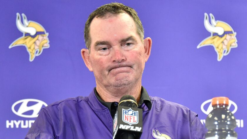 Minnesota Vikings head coach Mike Zimmer answers a question during meeting with reporters following