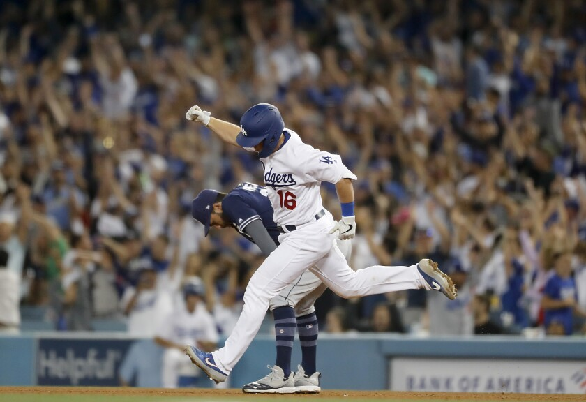Dodgers catcher Will Smith rounds the bases after hitting a grand slam against the San Diego Padres in the sixth inning Thursday at Dodger Stadium.