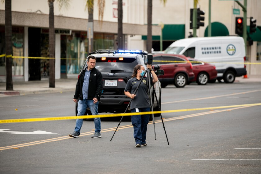 Investigators search for evidence last week after Escondido officer shot, killed Steven Olson at Second Avenue and Broadway.