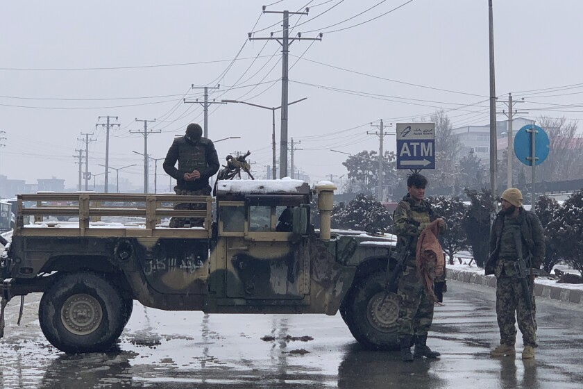 Afghan police arrive at the site of an explosion near a military academy in Kabul, Afghanistan, on Tuesday.