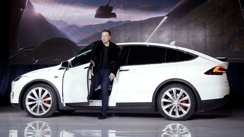 Tesla Motors CEO Elon Musk introduces the Model X at Tesla's headquarters in Fremont, Calif. in 2015.