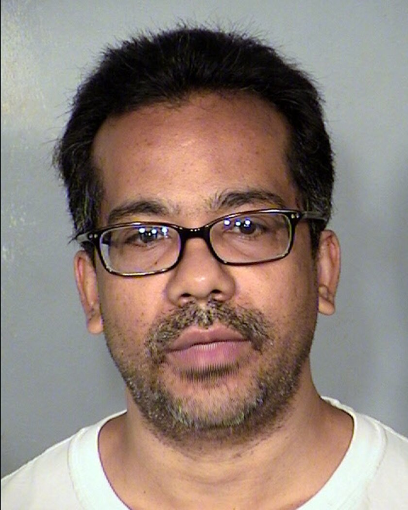 This Aug. 5, 2014 booking photo from the Las Vegas Metropolitan Police Department shows Steven Brooks following his return to custody in Las Vegas from a jail in California's San Bernardino County. Brooks is due Thursday, Aug. 7, 2014, before a Las Vegas judge on felony and misdemeanor charges stemming from a Feb. 10, 2013, arrest during a domestic dispute in Las Vegas. The former Nevada lawmaker spent 16 months in jail for fighting with California police after a high-speed freeway chase. (AP Photo/Las Vegas Metropolitan Police Department)