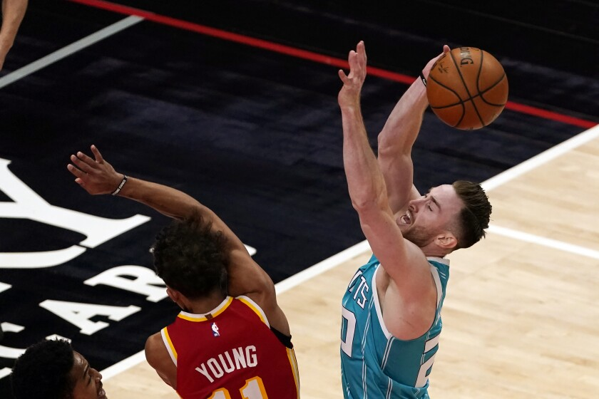 Charlotte Hornets forward Gordon Hayward (20) is fouled by Atlanta Hawks guard Trae Young (11) during the second half of an NBA basketball game Wednesday, Jan. 6, 2021, in Atlanta. (AP Photo/John Bazemore)