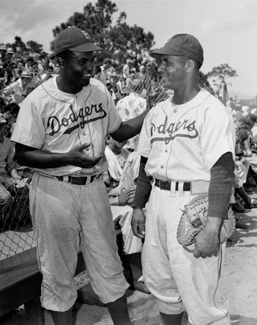 Jackie Robinson, left, and Roy Campanella in 1948.