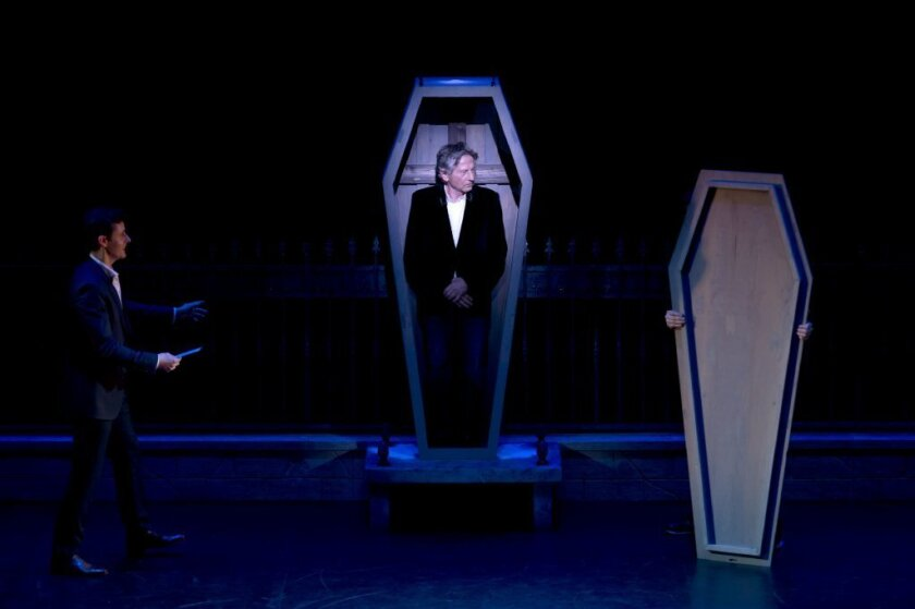 """Roman Polanski stands in a coffin as he takes part in a Paris press conference on Monday to present the musical """"Le Bal des Vampires."""""""