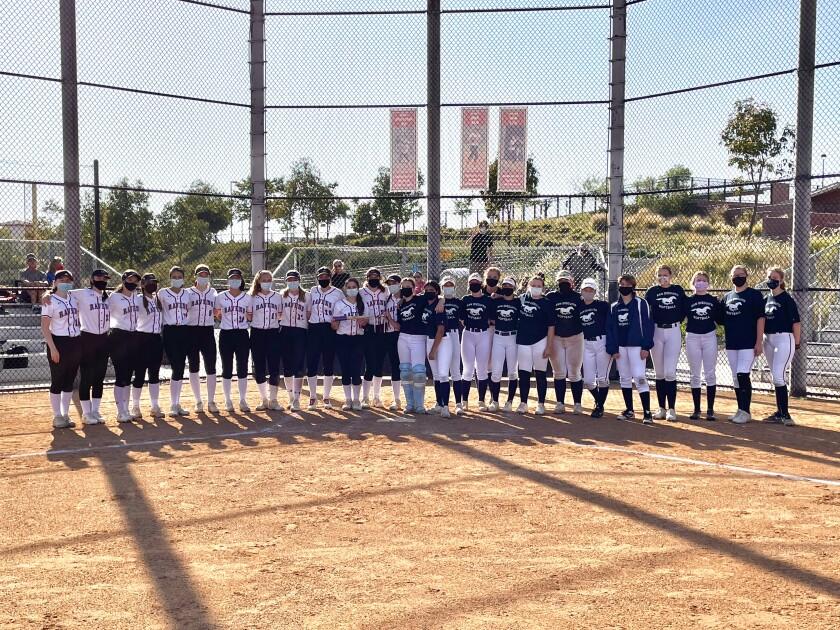 The CCA and SDA softball teams at the Battle of the Academies.