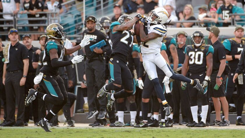 Jacksonville Jaguars cornerback A.J. Bouye, left, intercepts a pass intended for Chargers receiver Travis Benjamin in overtime.