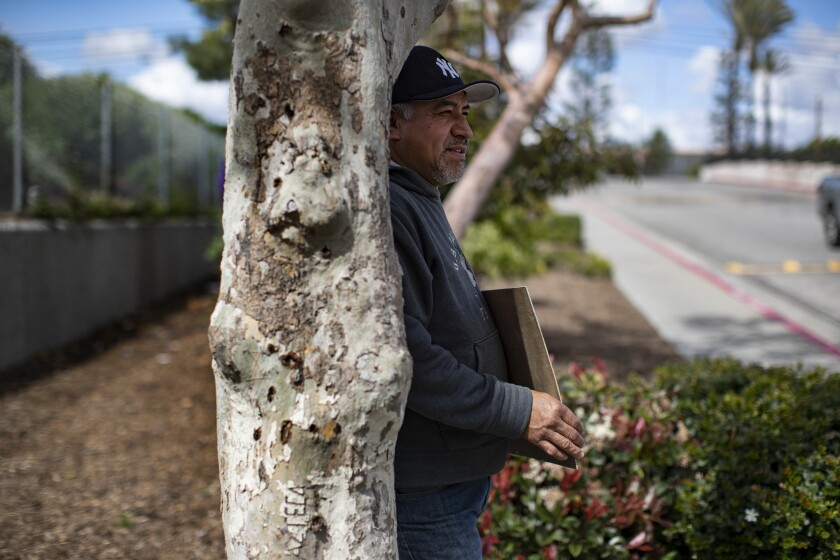 Gabriel Reyes, 49, of Bellflower was laid off  during the pandemic and is now trying to get work as a day laborer outside Paramount Home Depot.