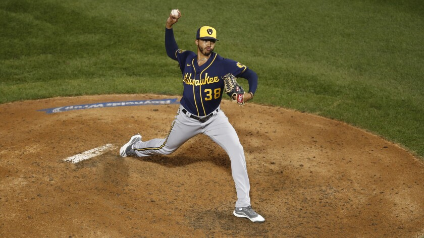 Milwaukee Brewers reliever Devin Williams pitching against the Chicago Cubs
