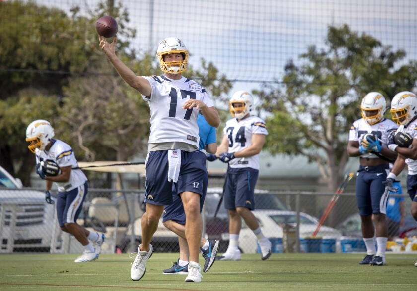 Quarterback Philip Rivers throws a pass as the Los Angeles Chargers conduct their first training camp practice of 2019 at Jack R. Hammett Sports Complex in Costa Mesa on Thursday.