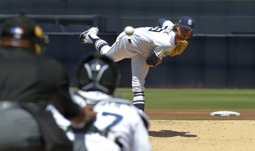 Padres rookie pitcher Chris Paddack fights out of a bases-loaded jam in the first inning Wednesday against the Mariners at Petco Park.