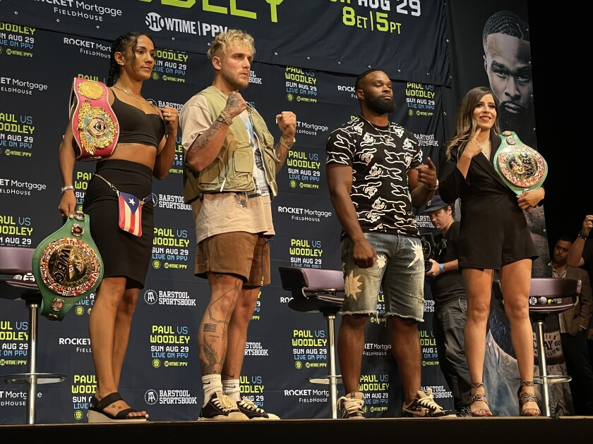 Amanda Serrano, Jake Paul, Tyron Woodley and Yamileth Mercado stand on the podium at The Novo after their news conference.