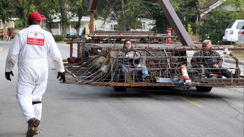 Ryan Babroff, of Pasadena, left, and Ernest Koeppen, of La Canada, test drive to test the road capab