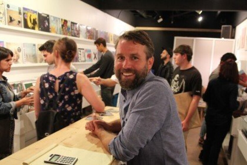 M-Theory Music general manager Rick Tyner in Flower Hill Promenade's new record store in the Row Collective.