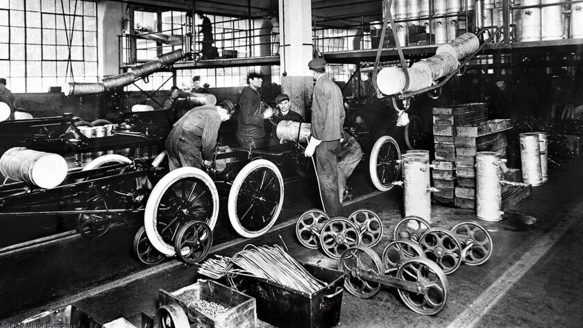It was simpler in the old days: Laborers work on a Ford assembly line in the 1920s.