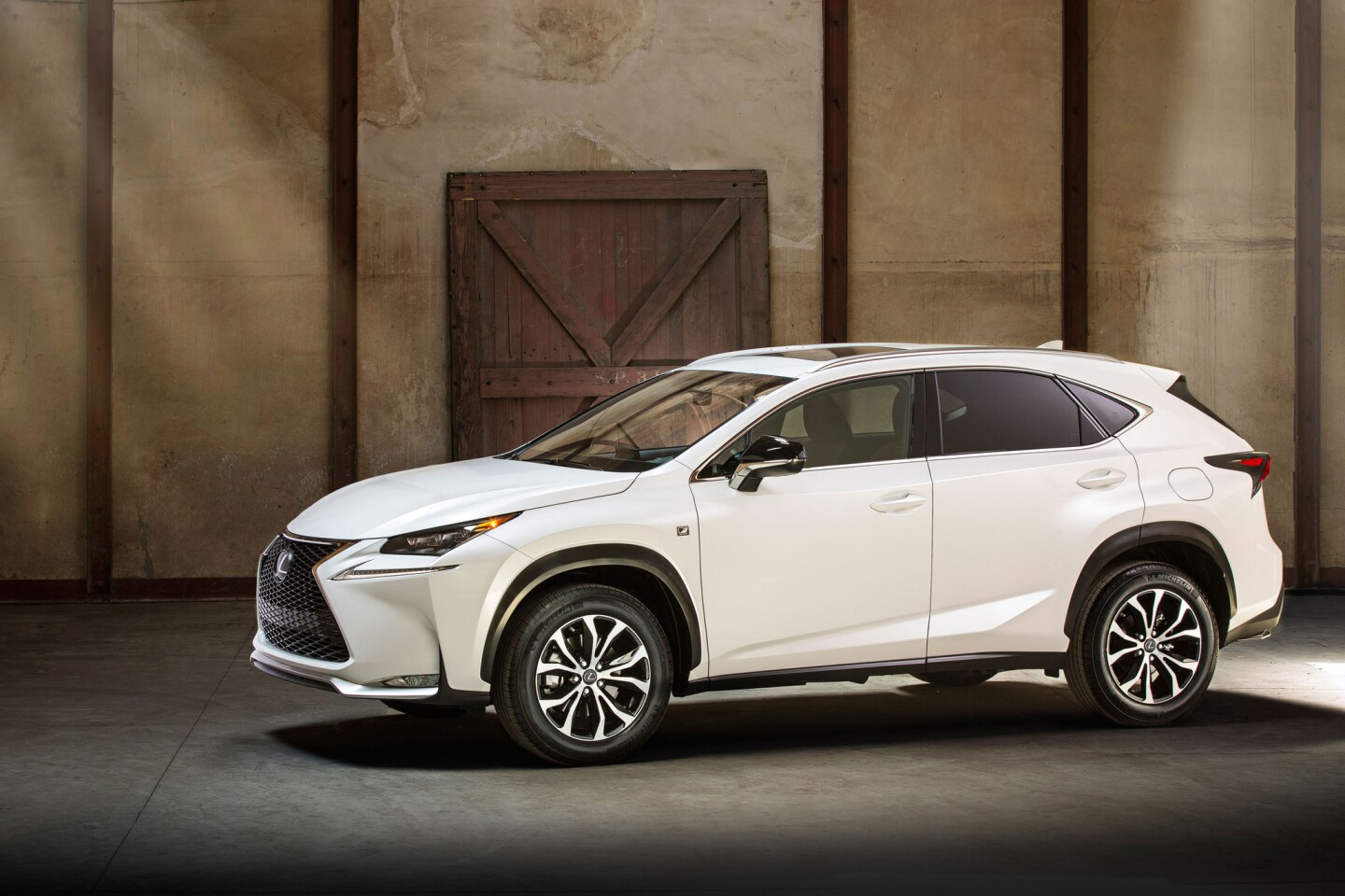 The Lexus NX compact crossover will come with either the first turbocharged engine the company has offered, or a four-cylinder hybrid. It slots below the popular RX crossover in the luxury brand's lineup.