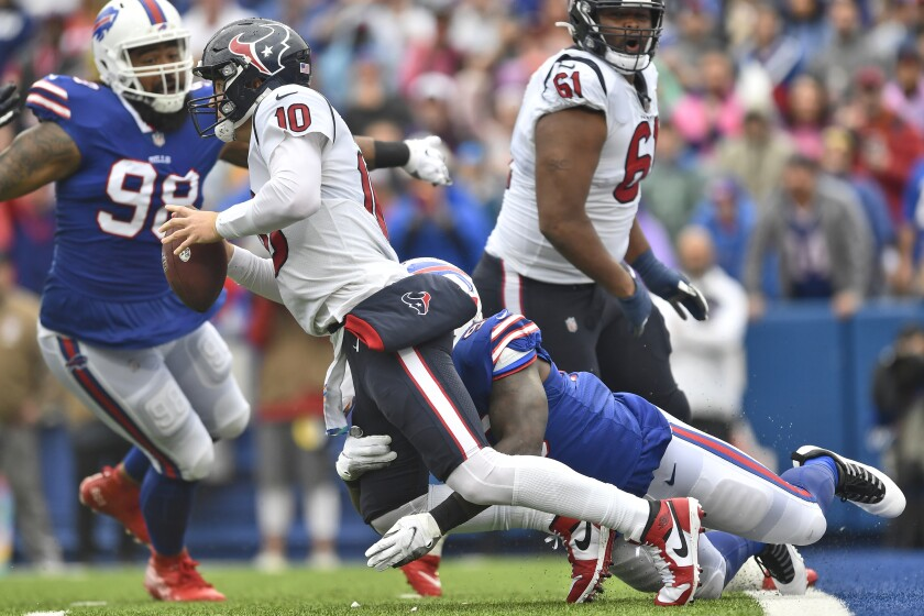 Houston Texans quarterback Davis Mills (10) is sacked by Buffalo Bills defensive end Boogie Basham (96) during the first half of an NFL football game, Sunday, Oct. 3, 2021, in Orchard Park, N.Y. (AP Photo/Adrian Kraus)