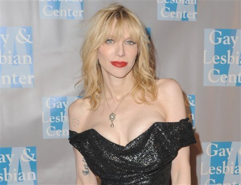 """FILE - In this May 19, 2012 file photo, musician Courtney Love attends """"An Evening With Women,"""" in Los Angeles. Love's former assistant sued the Hole front-woman on Tuesday, July 10, 2012 in Los Angeles, claiming the rocker owes her unpaid wages and asked her to perform unethical duties such as hir"""