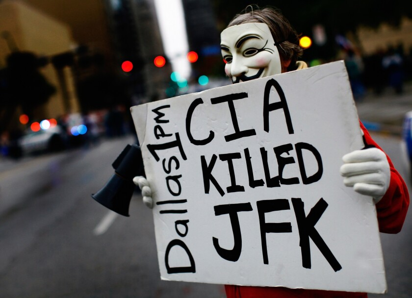 A lone protester stands outside the John F. Kennedy Memorial Plaza in Dallas, Texas, on Nov. 22, 2013 – the 50th anniversary of the assassination of the 35th U.S. president.