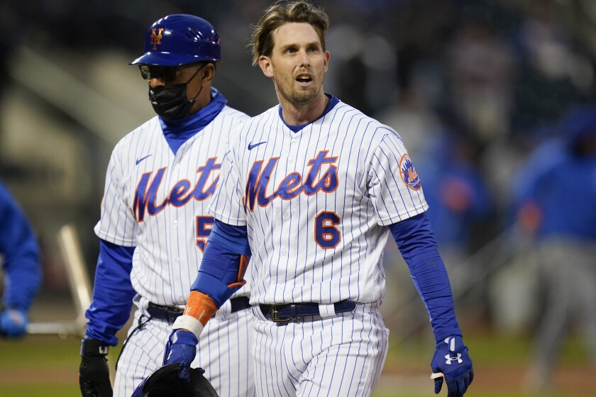 New York Mets' Jeff McNeil (6) leaves the field after being hurt during the third inning of the team's baseball game against the Baltimore Orioles on Tuesday, May 11, 2021, in New York. (AP Photo/Frank Franklin II)