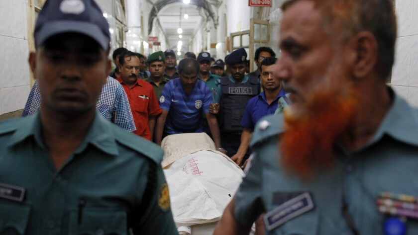 Authorities with the body of Faisal Arefin Deepan, a secular publisher killed in a 2015 machete attack at his office.