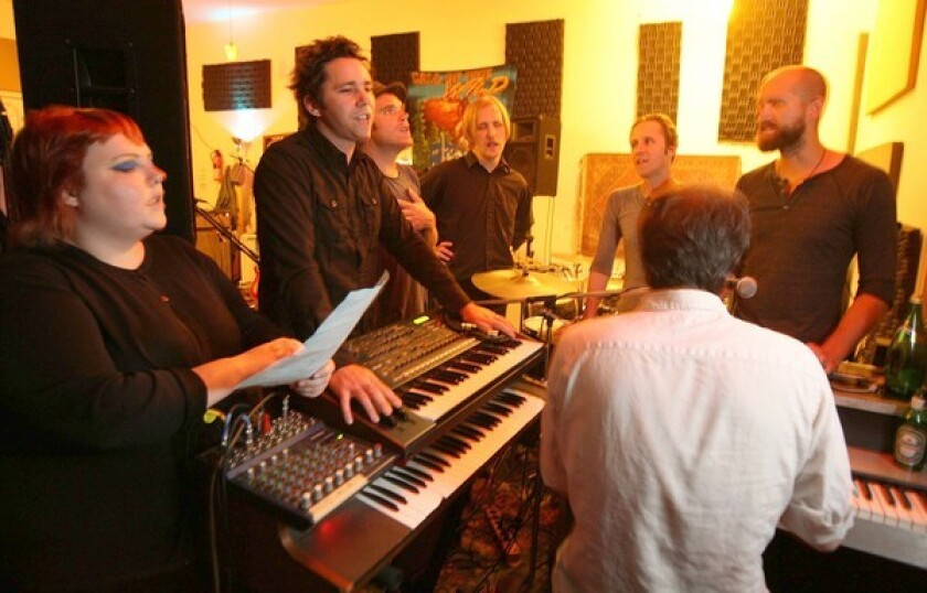 Members of the L.A. band the Afternoons -- from left, Claire McKeown, Steven Scott, Brian Canning, Tom Biller, Brent Turner, Sam Johnson and Aaron Burrows at the keyboards -- practice in the studio. They're changing the band's name to Shadow Shadow Shade to avoid being confused with other bands on Google searches.