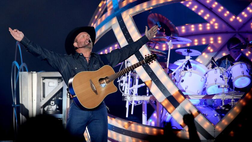 Garth Brooks soaks up fans' adoration during his performance Saturday at the Forum in Inglewood.