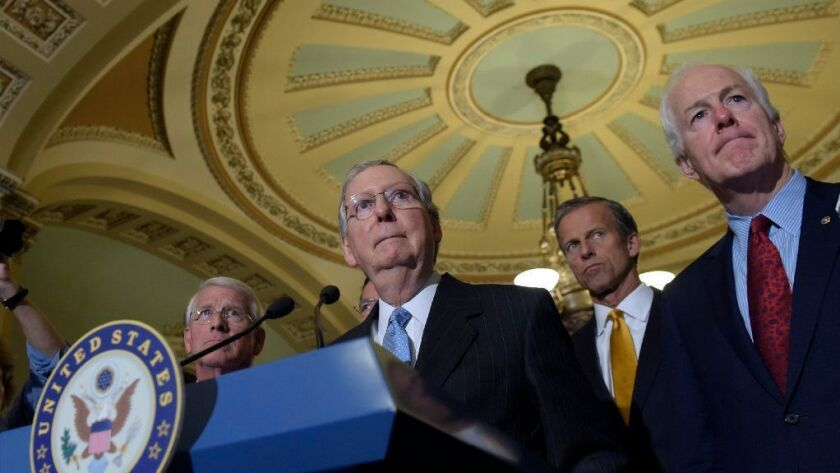 Senate Majority Leader Mitch McConnell of Ky., second from left, standing with, from left, Sen. Roger Wicker, R-Miss., Sen. John Thune, R-S.D., and Senate Majority Whip John Cornyn, of Texas, listens to a question during a news conference on Capitol Hill in Washington.