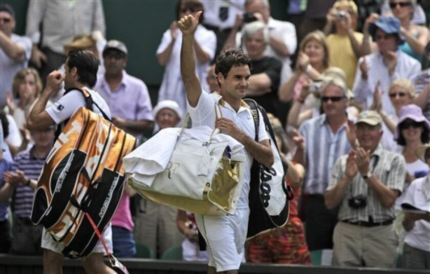 Roger Federer, right of Switzerland acknowledge the crowd after defeating Tommy Haas, left of Germany in their semifinal match on centre court at Wimbledon, Friday, July 3, 2009. (AP Photo/Anja Niedringhaus)