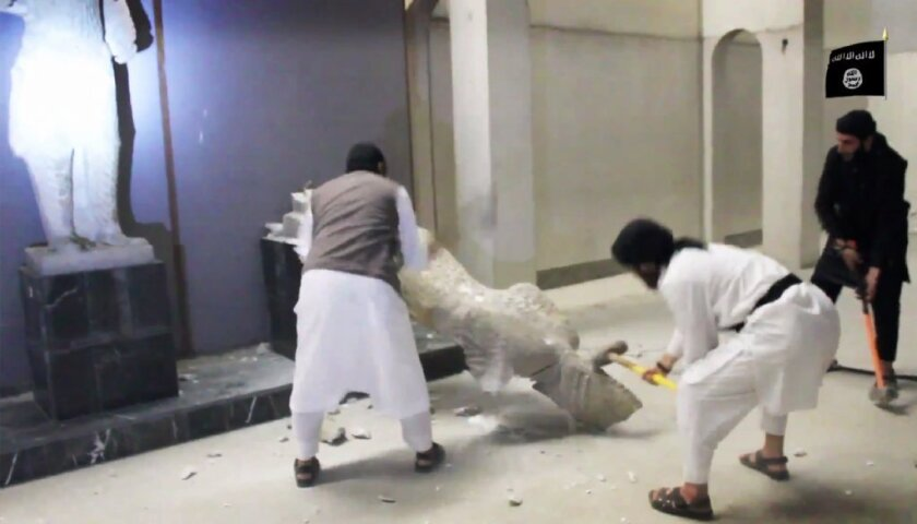 The Islamic State propaganda video showing statues being smashed may be a cover for Mosul Museum looting