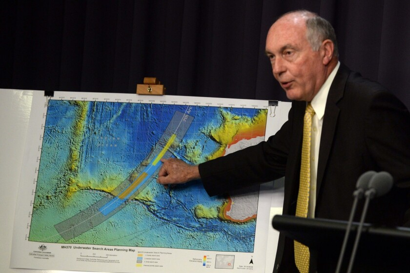 Australian Deputy Prime Minister Warren Truss shows the new search area in the Indian Ocean for the missing Malaysia Airlines jet. Truss spoke at the Parliament House in Canberra.