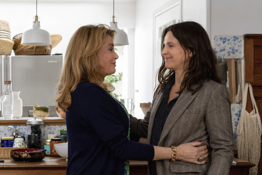 """This image released by IFC Films shows Catherine Deneuve, left, and Juliette Binoche in a scene from """"The Truth."""" (IFC Films via AP)"""
