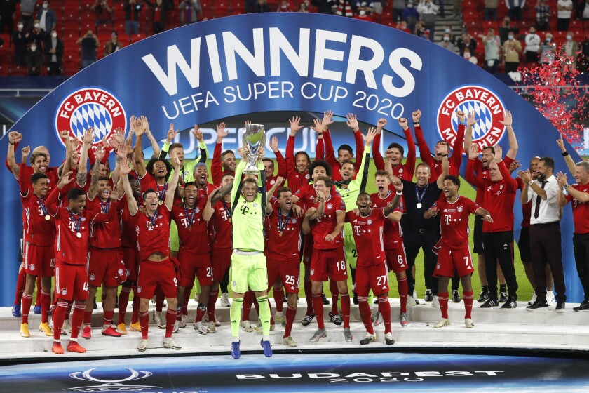 Bayern's goalkeeper Manuel Neuer lifts the trophy after the UEFA Super Cup soccer match between Bayern Munich and Sevilla at the Puskas Arena in Budapest, Hungary, Thursday, Sept. 24, 2020. Bayern won the match 2-1 after extra time. (Bernadett Szabo/Pool via AP)