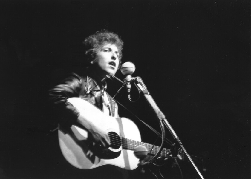 Bob Dylan performs during the Newport Folk Festival at Freebody Park in Newport, R.I., on July 25, 1965.
