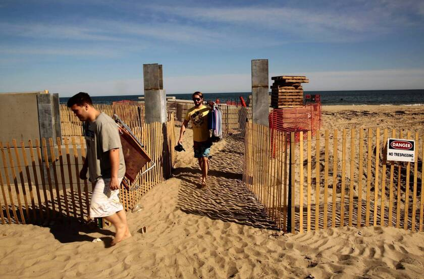 A new seawall is being built to help protect the homes in Rockaways, a beach community in New York, after Superstorm Sandy hit last fall.