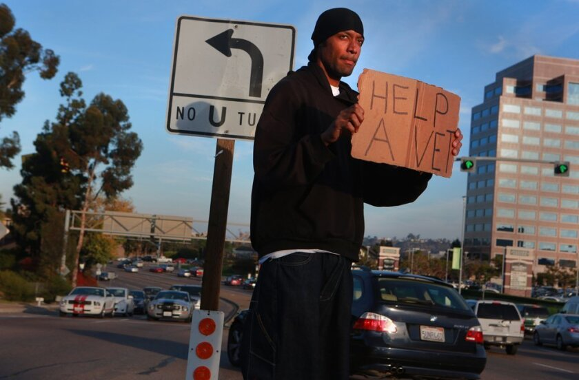 Jason, a veteran of the U.S. Navy, panhandles on Friars Road after a disappointing job interview at Goodwill..