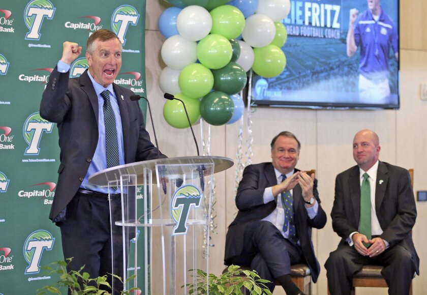As Tulane president Michael A. Fitts and athletic director Troy Dannen, right, look on, Willie Fritz cheers as he is formally introduced as head football coach during a news conference at Yulman Stadium at Tulane University in New Orleans on Tuesday, Dec. 15, 2015. (Michael DeMocker/NOLA.com The Ti
