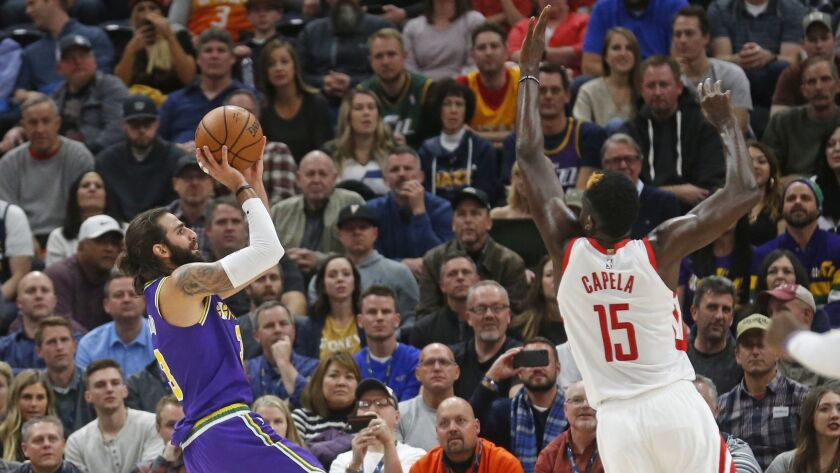 Utah Jazz guard Ricky Rubio (3) shoots as Houston Rockets center Clint Capela (15) defends during the first half.