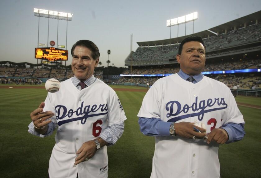 Former Dodgers Steve Garvey (6) and Fernando Venezuela are shown Sept. 16, 2006, during a celebration of the 1981 title team.