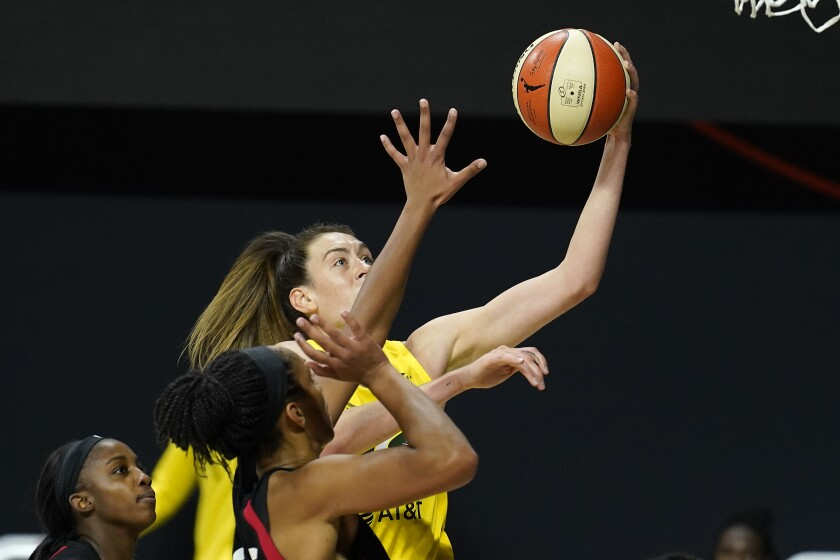 Seattle's Breanna Stewart shoots over Las Vegas' Jackie Young and A'ja Wilson in Game 1 of the WNBA Finals on Oct. 2, 2020.