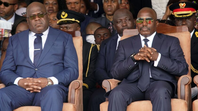Congolese President Felix Tshisekedi, left, and outgoing president Joseph Kabila sit side by side du