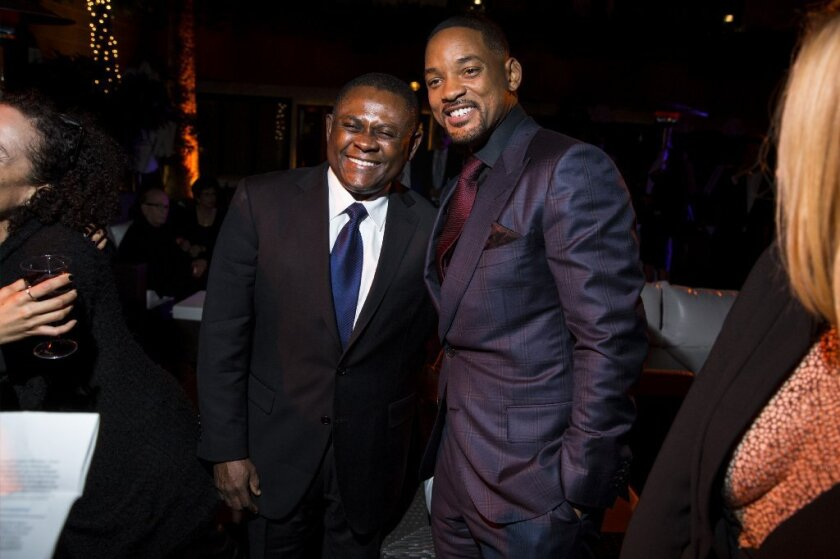 """Actor Will Smith and Dr. Bennet Omalu, whom Smith portrays, attend the party following the AFI Fest premiere of """"Concussion."""""""