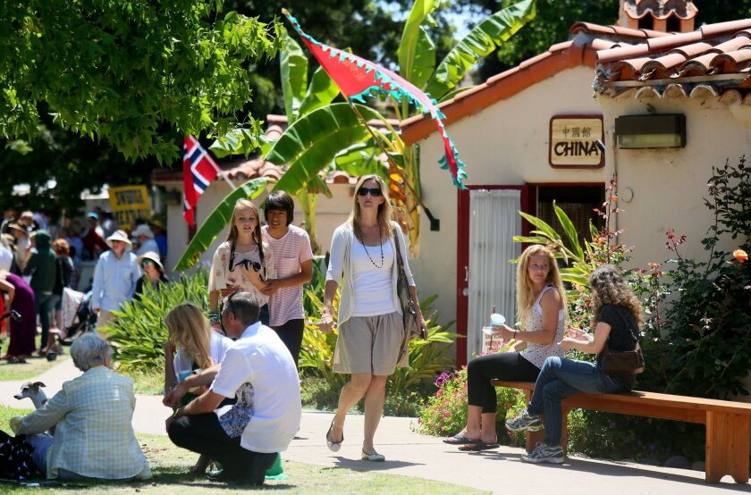 In this file photo, crowds hang-out at the International Cottages in Balboa Park on a Sunday. Mexican community members are calling on the House of Pacific Relations, which oversees the cottages, to give the House of Mexico a stand-alone cottage. Photo: Sandy Huffaker