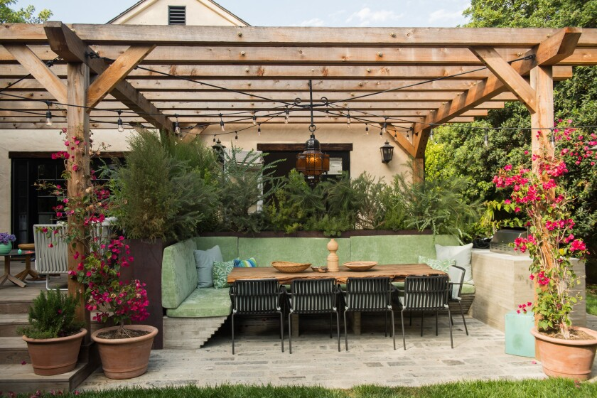 A new sunken outdoor dining area off of the kitchen is made of board-form concrete.