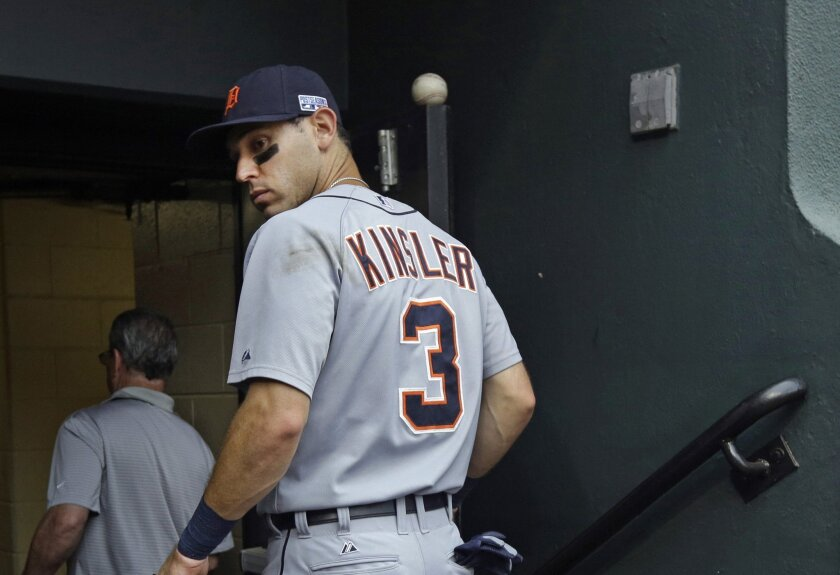 Detroit Tigers' Ian Kinsler walks into the clubhouse after Game 2 in baseball's AL Division Series against the Baltimore Orioles in Baltimore, Friday, Oct. 3, 2014. Baltimore won 7-6. (AP Photo/Patrick Semansky)